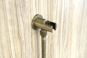 Reitano Rubinetteria Držák sprchy kulatý, pevný, s vyústěním, bronz 981M6